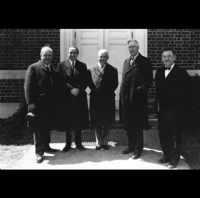 Convocation at Memorial Hall, W.H. Stout, Pierre DeLanux, Robert Milliken (speaker), President Frank L. McVey, O.T. Koppius